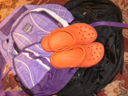 Orange shoes and clean back packs awaiting donation